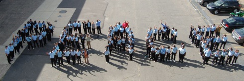 """Students standing in formation to spell out """"PEACE"""""""